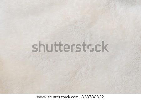 Blurred background of soft tissue. Beige background of plush fabric - stock photo