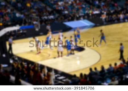 blurred background of sports arena crowd watching game                            - stock photo