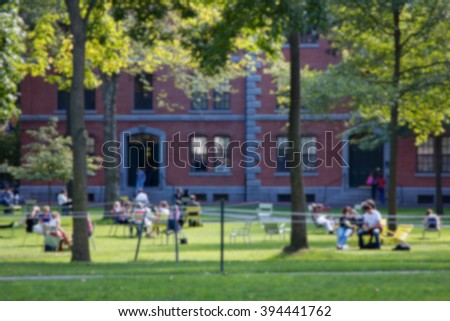 Blurred background of university campus scene. - stock photo