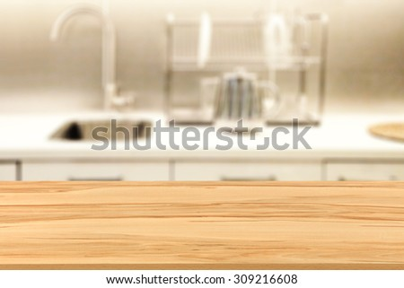Blurred Background Of White Kitchen Place And Furniture Top