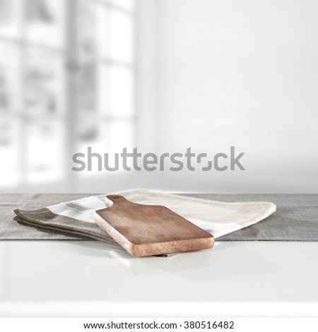 blurred background of window space and white table and brown kitchen desk