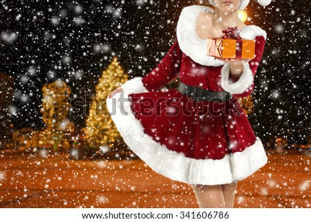 blurred background of winter night and girl  - stock photo