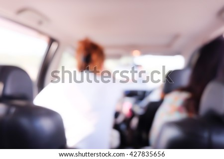 Blurred  background of women with friend in car.