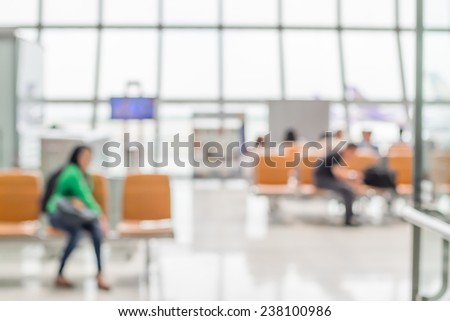Blurred background : Passenger waiting for flight at airport terminal blur background with bokeh light - stock photo