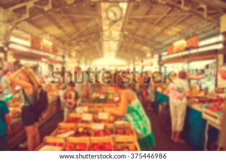 Blurred background : people shopping at market fair in sunny day, blur background - stock photo