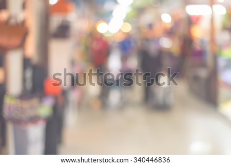 Blurred background : people shopping at market fair in sunny day, blur background with bokeh. Vintage effect style pictures. - stock photo