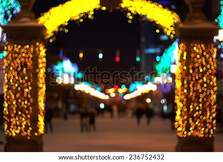 blurred background. street decorated with festive lights. Christmas city outdoors - stock photo
