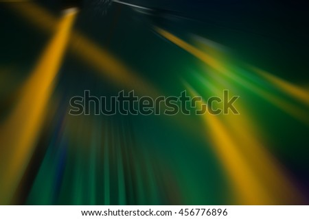 blurred background, the beams of searchlights on the background of dark scenes - stock photo