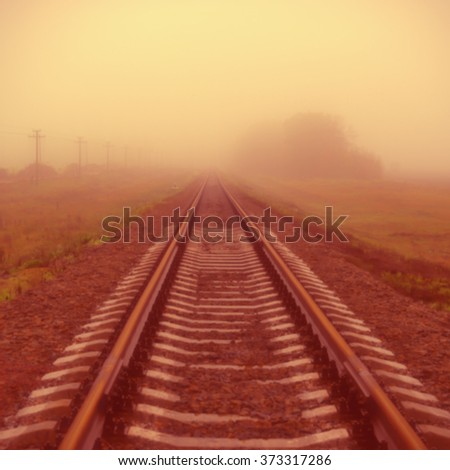 blurred background, the railway in the mist