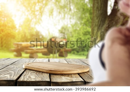 blurred background with young woman and shabby table and kitchen desk  - stock photo