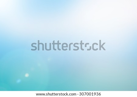 blurred backgrounds of sea with flare lights.blur image picture concept.pastel cool fresh tone colors.colorful of blue gradient backdrop:flash sparkle sunny:aura blurry wallpaper display for montage. - stock photo