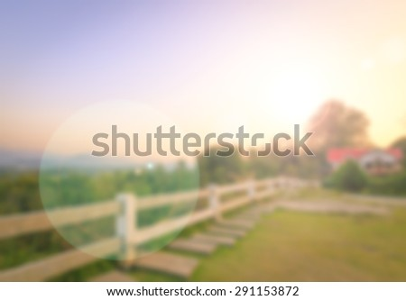 Blurred beautiful house on top of mountain  over colorful sunset background. - stock photo
