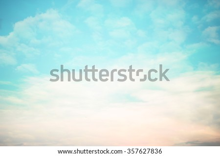 blurred beautiful natural sky clouds landscape background with lights.blurry sunshine wallpaper concept.backdrop pastel cool tone.idyllic shores sundown hour.abstract dream magic coastline dramatic - stock photo