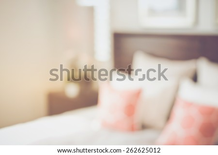 Blurred Bedroom with Bed and Nightstand with Retro Instagram Style Filter - stock photo