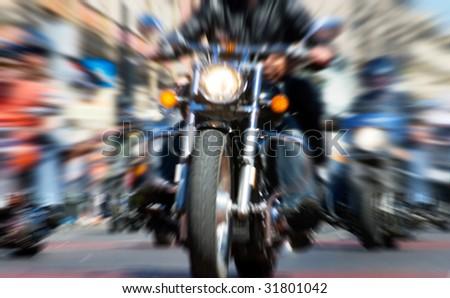blurred bike riders rushing at city streeet - stock photo