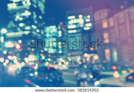 Blurred blue and pink urban building background illuminated at night - stock photo