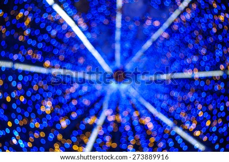 Blurred blue and Yellow twinkle Background shoot from inside of christmas tree - stock photo