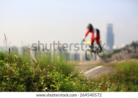 blurred BMX bike background / front grass focus selected