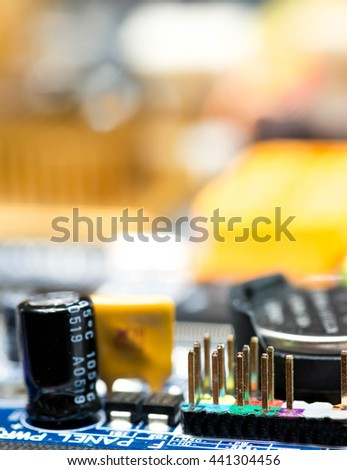 blurred bokeh blue pcb motherboard chip microchip integrated circuit board pattern background with copy-space - stock photo