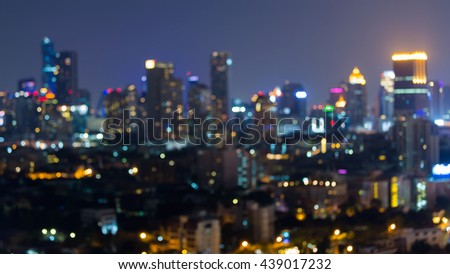 Blurred bokeh lights city office abstract background - stock photo