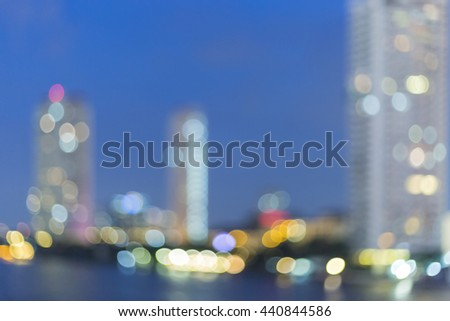 Blurred building on the river at night - stock photo