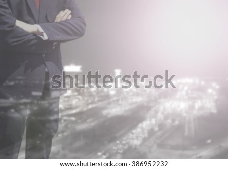 Blurred Business man success or soft Business man success in he working on marketing online or e learning with global learning on over blur or blurred top city view with light flare from corner.  - stock photo