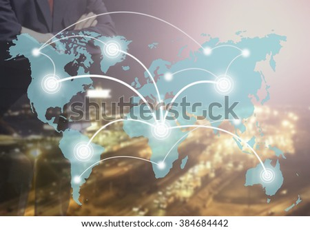 Blurred Business man success or teach on marketing online or e learning with global learning link on world map sky color tone on over blur or blurred night city with orange light background.  - stock photo