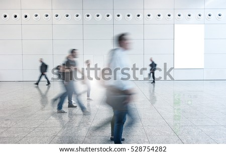 Blurred business people walking in a floor