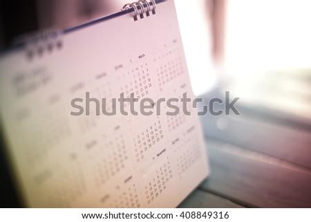 blurred calendar in dramatic tone. - stock photo