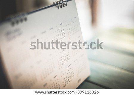 Blurred calendar page dark tone - stock photo