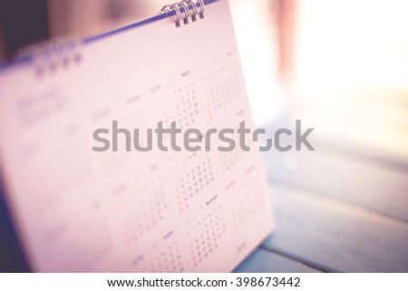Blurred calendar page pink tone - stock photo