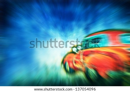 Blurred car and blue sky with clouds - stock photo