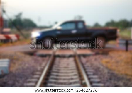 Blurred car railroad crossing - stock photo
