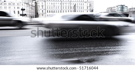 Blurred cars on the city road - stock photo