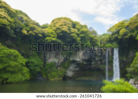 Blurred Cheonjiyeon Waterfall is a waterfall on Jeju Island, South Korea. The name Cheonjiyeon means sky. This picture could be use in promoting the place. - stock photo
