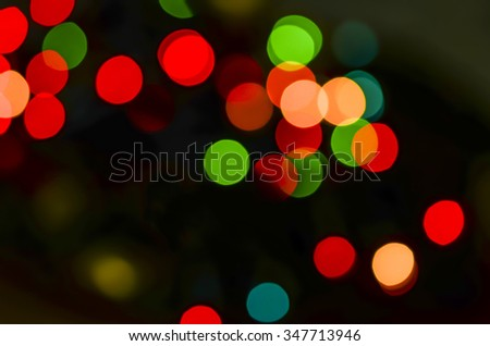 Blurred christmas lights decoration in the night sky / Abstract background / The great feelings of holiday around