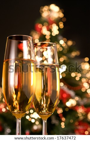 Blurred christmas tree and two champagne glasses - stock photo