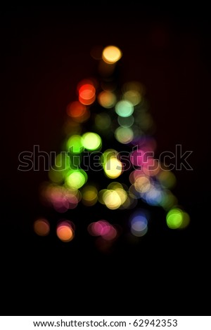 Blurred christmas tree lights isolated on black - stock photo