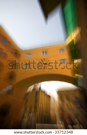 Blurred clock on a wall in Stockholm City - stock photo
