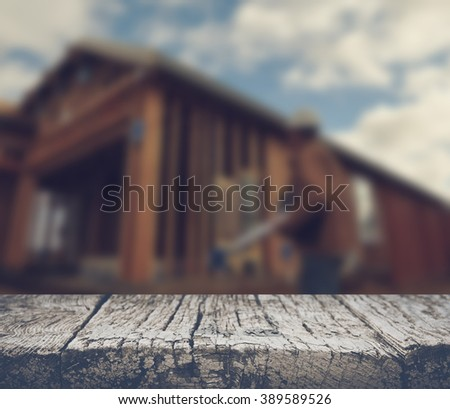 Blurred Construction Worker Inspecting Home Construction Site with Retro Style Filter - stock photo