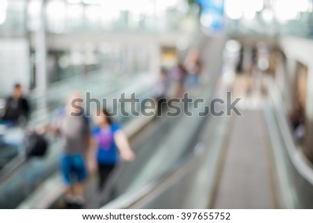 Blurred crowd of passenger on the elevator at the airport - stock photo