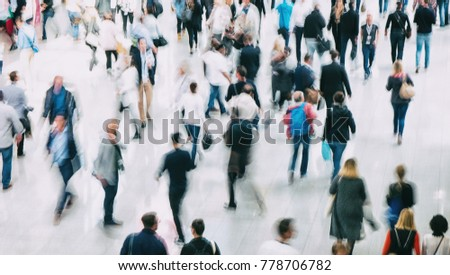 blurred crowd of people rushing