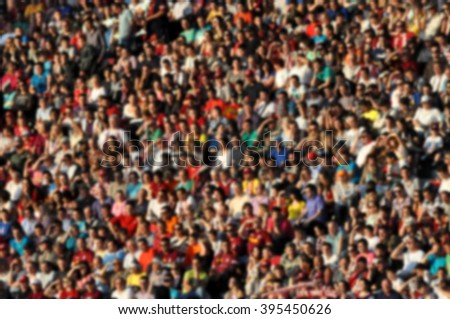 Blurred crowd of spectators in a stadium - stock photo