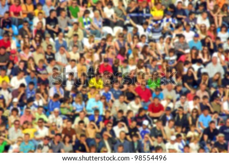 Blurred crowd of spectators on a stadium tribune at a sporting event - stock photo