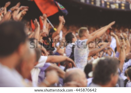 Blurred crowd of spectators on stadium at a sporting event - stock photo