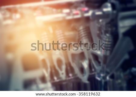 Blurred cut metal car engine part - stock photo