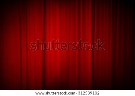Blurred dark background: closed red theater curtain. - stock photo
