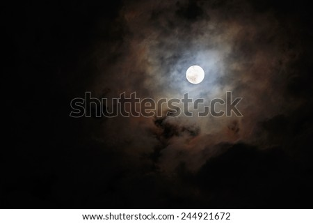 Blurred - dark stormy sky with moon - stock photo