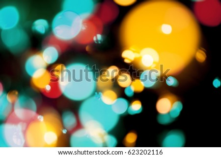 Blurred de-focused bokeh lights on black background