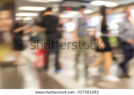 Blurred defocused abstract background of people in subway - stock photo